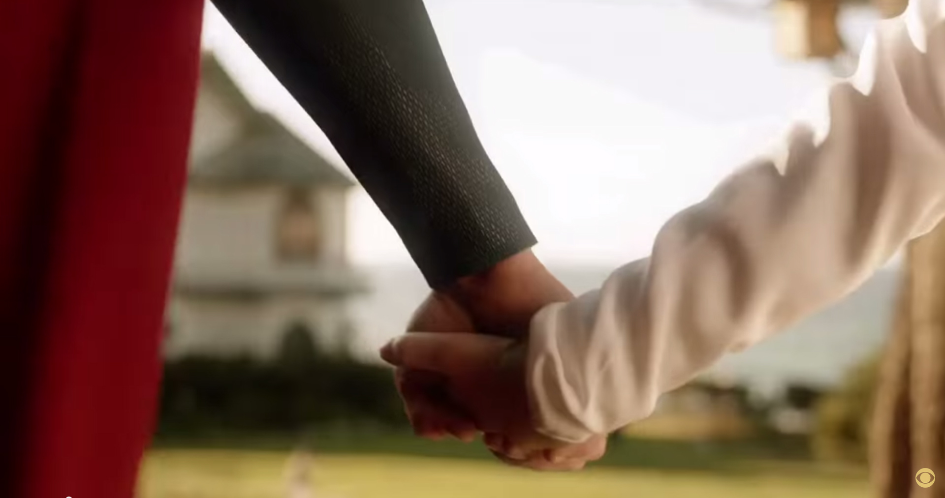 Kal and Kara holding hands